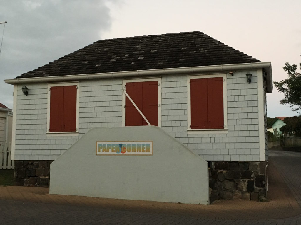 In the 18th-century this building served as the local rum shop. Today, it's the local office supply shop. Many buildings in Statia took advantage of space so that the widest part of the building fronted the street.
