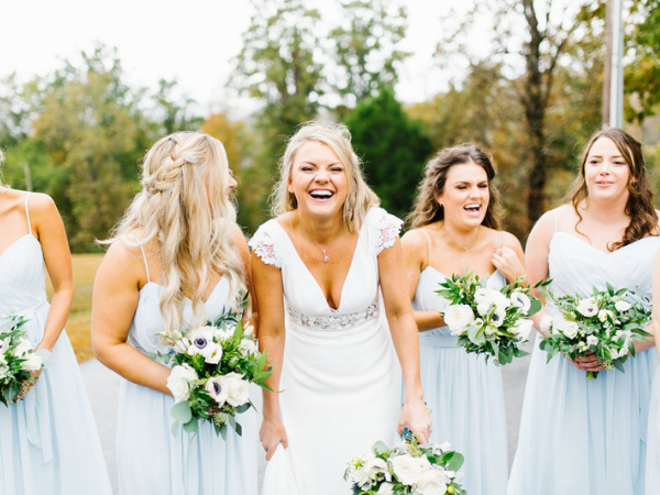 Bride and bridesmaids in light blue dresses. Photo by Feiten Photography.
