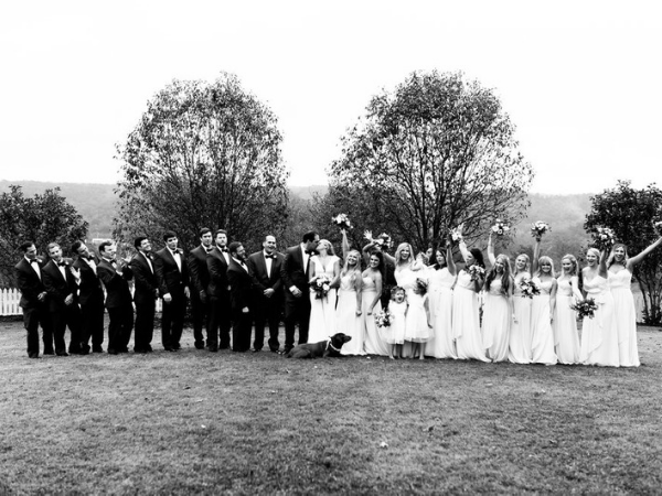 Entire wedding party celebrating at Front Porch Farms. Photo by Feiten Photography.