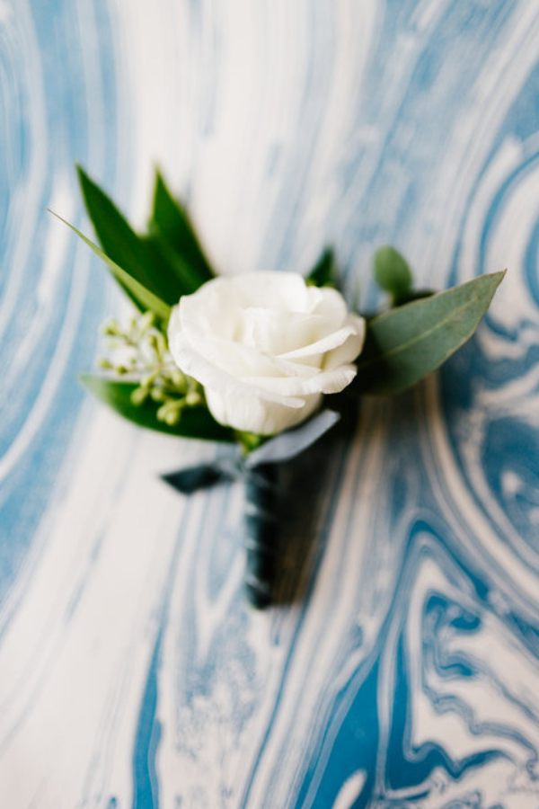 White Rose boutonniere by Front Porch Farms Florals. Photo by Feiten Photography.