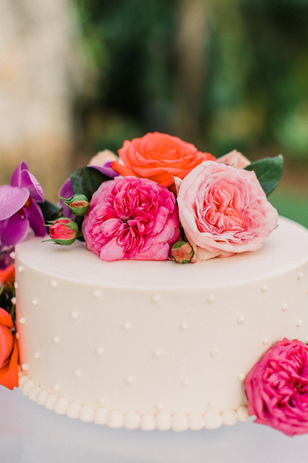 Real Wedding at Naples Botanical Garden Tropical Wedding Ideas bold bright florals on wedding cake.png