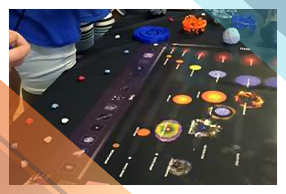 A stellar evolution infographic laid out on a table.