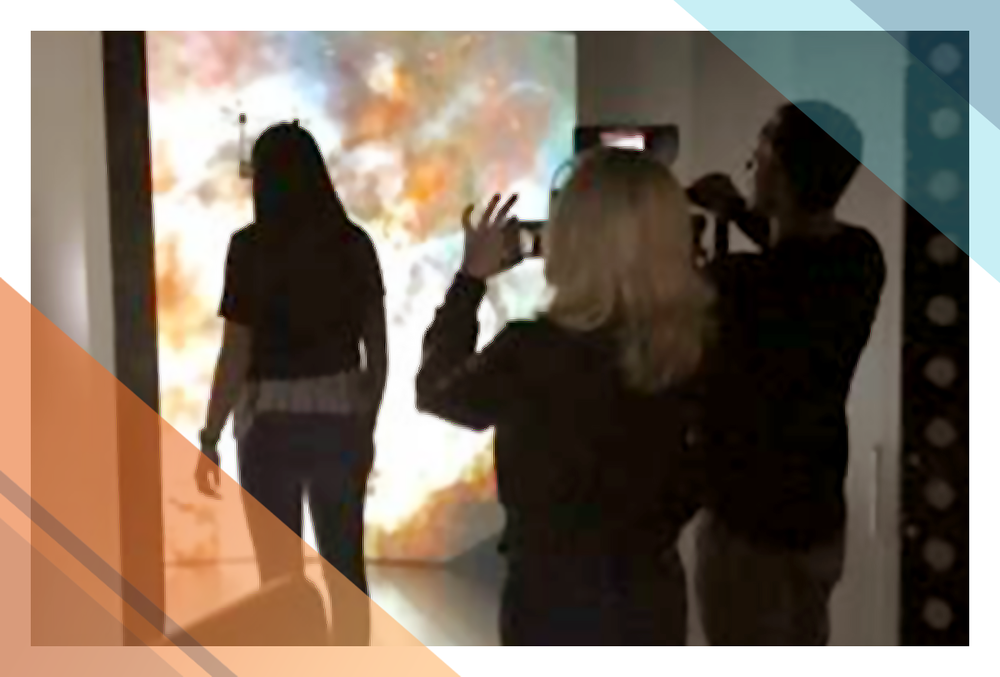 Participants experience and photograph a supernova exhibit at Brown University.