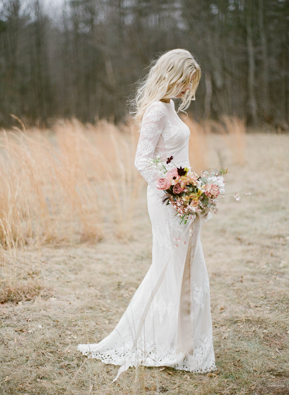 bride in meadow by anda ambrosini.jpg