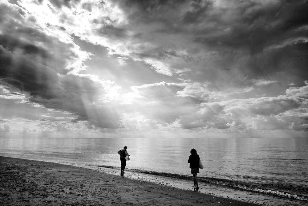 Today is the first day that I have put on a jumper whilst in the office, a sure sign that the seasons are changing. Seems hard to believe that a week ago when taking this image it was mid to high 20's in Norfolk.  Here two lady's walk back to Hunstanton amazed as I was at the incredible cloud v sun's rays taken on my Leica Mono 246 using the Lee filter Seven5 set up. A grad .9 ND on the top half and a .6ND on the bottom. It was the first time of using the small and very easy to use filter system and what a difference.   The final set of images from Norfolk can be seen here, https://www.jonnicholson.co.uk/artists/#/beneath-the-cliff/