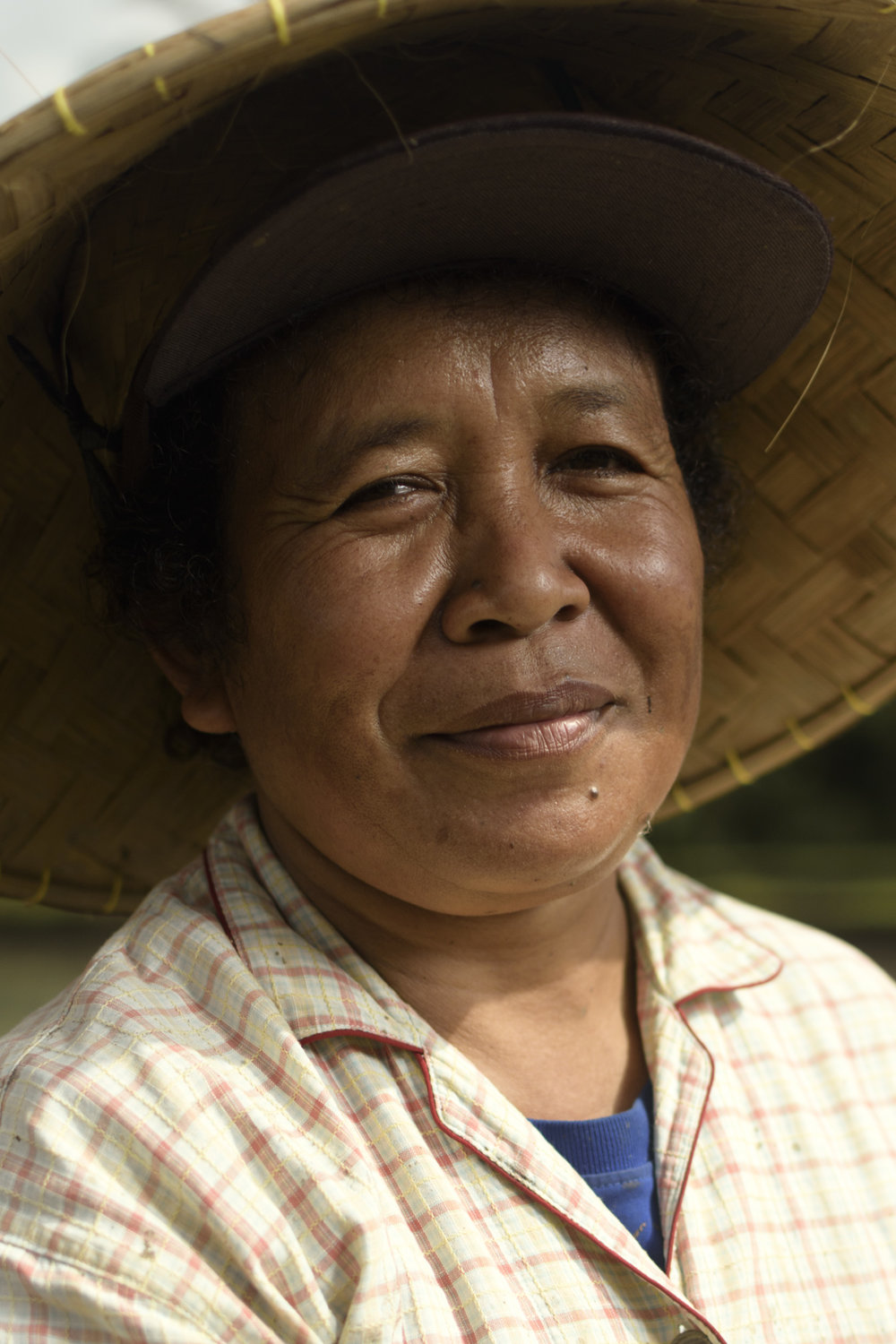 Portrait of a women rice farmer in Bali. Women play a very important part in the rice fields, working as hard as their male counterparts.
