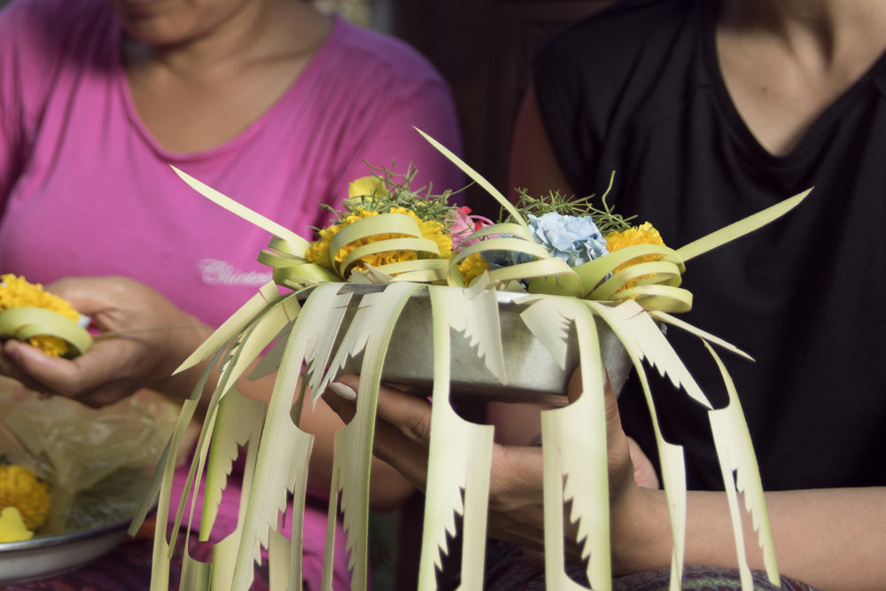 Once the 'Canang Sari' is created, is is filled with offerings such as petals, coins and grains of rice.