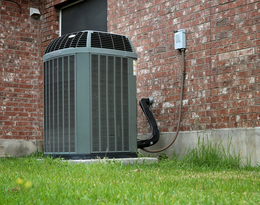 Outdoor ac-heater unit by brick wall