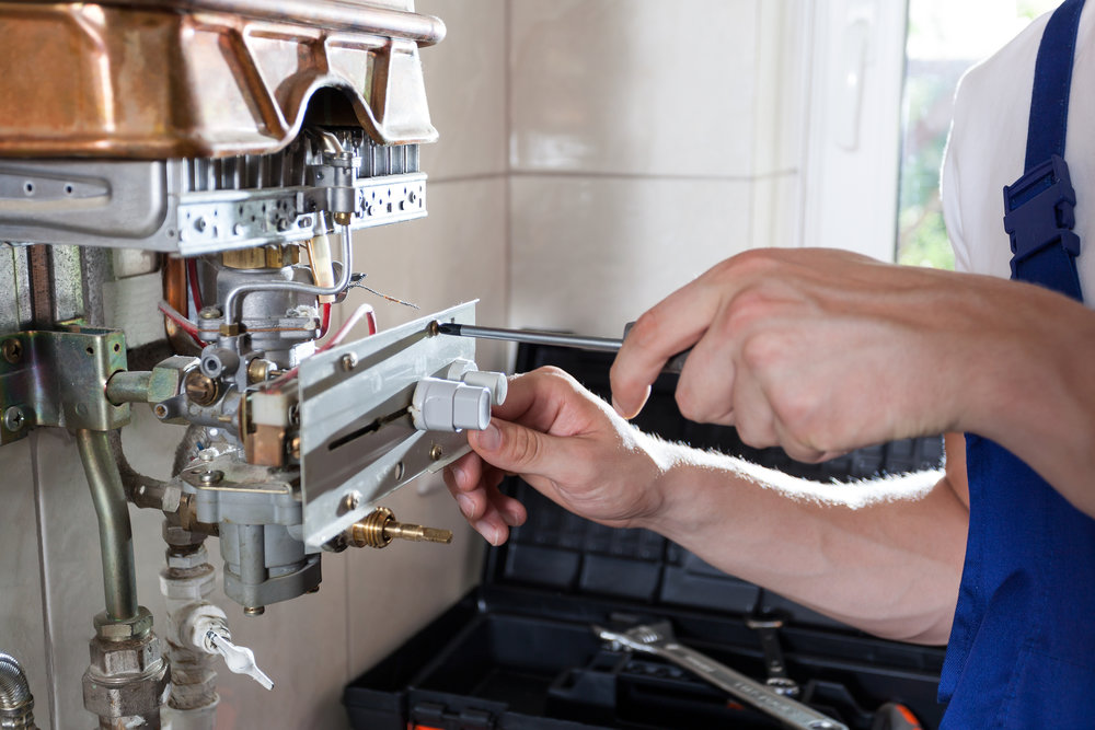 Repairman servicing water heater