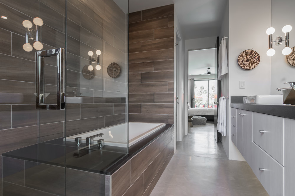 All private bathrooms - 5 Palms Estate features 6 bedroom suites, each with private bathroom. All suites feature oversized, glass-enclosed showers and one also features a 6 foot soaking tub and outdoor shower, sink and leathered granite floating countertop.