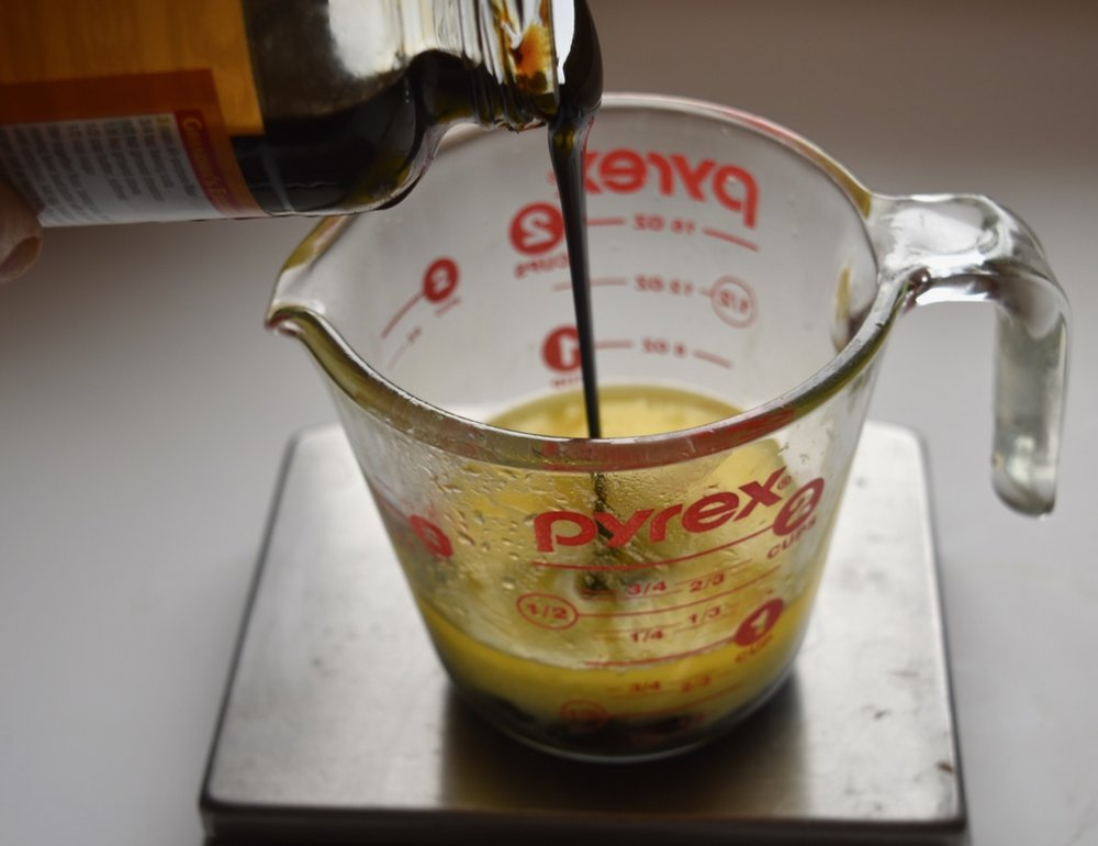 Measuring the molasses into the melted butter means it will pour out of the cup without sticking.