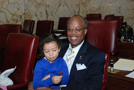 Senator McFadden on the Senate floor with his granddaughter