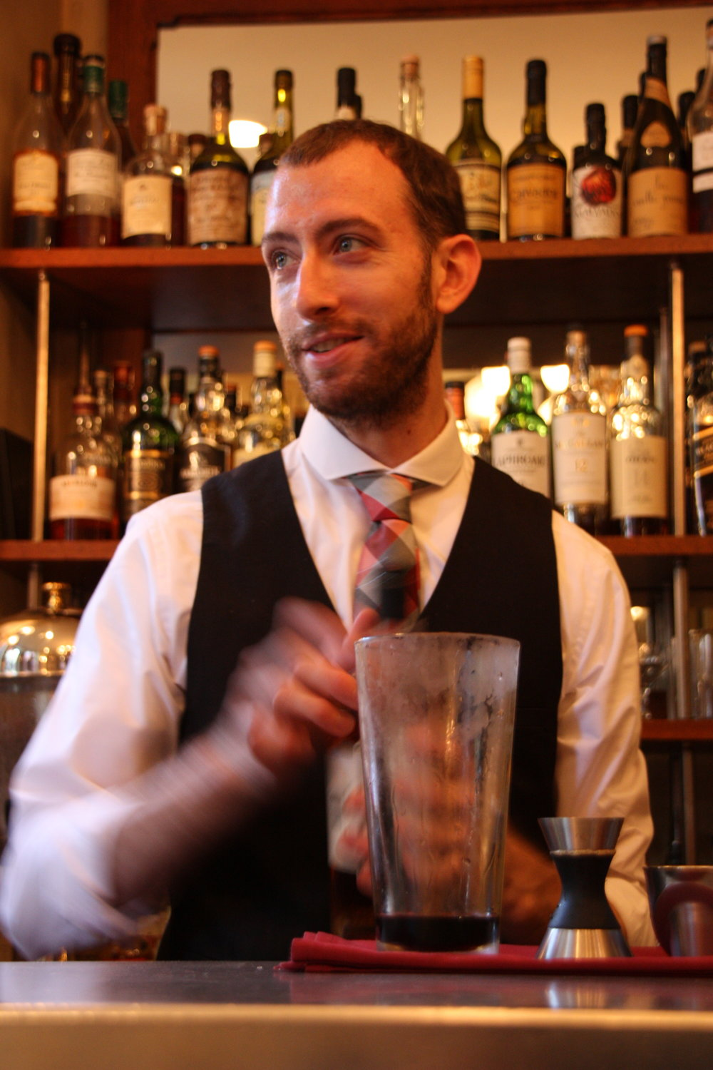 Rory Caviness    La Joie De Vivre  1.25 oz. Wolfberger Amer Fleur De Joie .75 oz. Ransom Old Tom Gin .25 Ardbeg 10 Single Malt Scotch 1 dash Bitter Truth Jerry Thomas' Own  Smoke lemon twist and a half cinnamon slick over a stone surface with a torch. Place a chilled old fashioned glass over top and let the aromatics fill the glass. Stir above ingredients over ice to chill, then strain into glass over on large ice cube.    Peaky Blinders  .75 oz Wolfamer  .75 oz Mad River Rye Whiskey .50 oz La Quintinye Rouge Vermouth .25 oz Fernet Branca 2 dashes Bittermen's Xocolatl Mole   Stir above ingredients with ice, then strain into a really old fashioned glass.   Created by Rory Caviness for La Voile Boston, Massachusetts Photo: Connor Button
