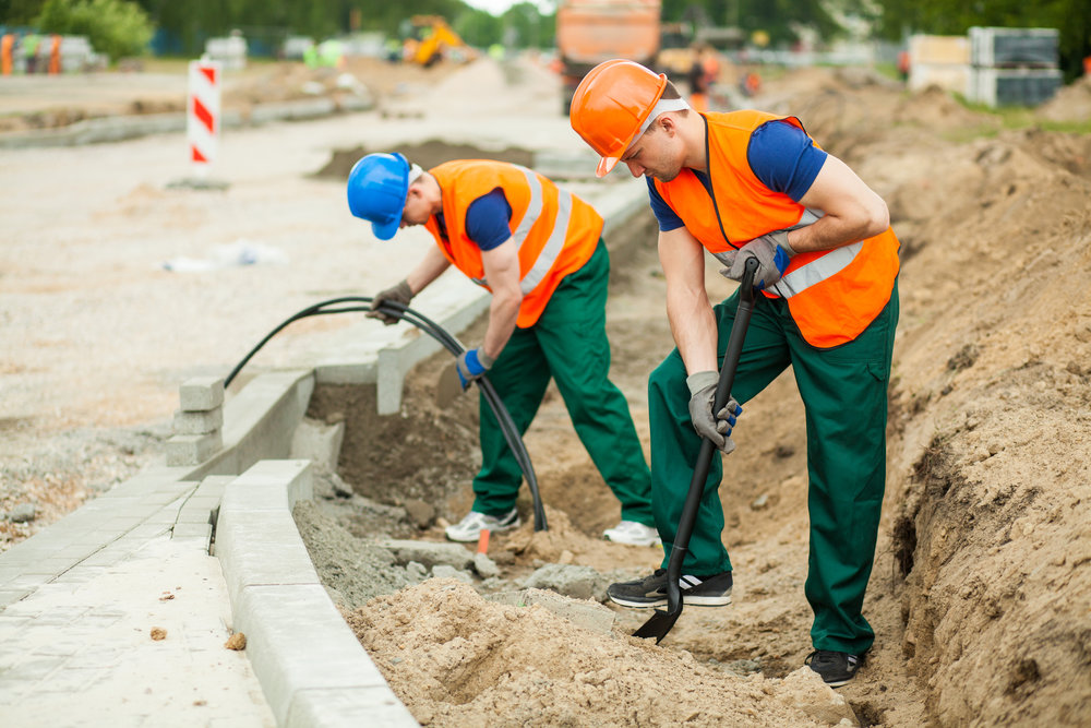 two construction workers working on site