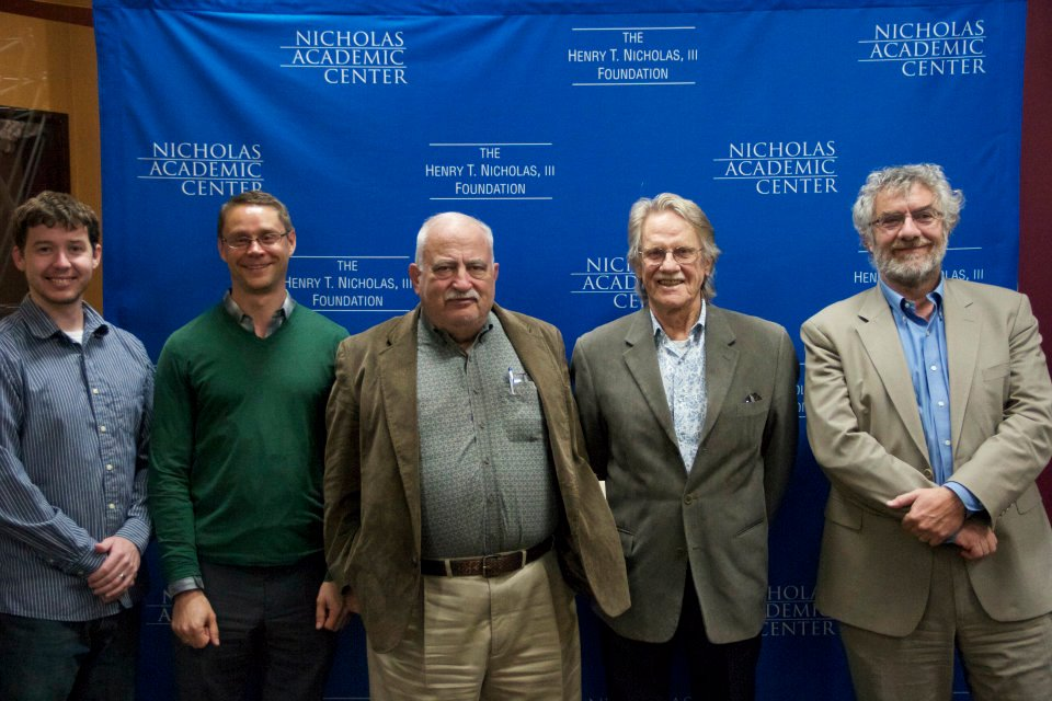 Board of Director Jack Mandel posing with Noble Prize winner for Experimental Economics Dr. Vernon Smith, his colleagues Dr. Bart Wilson and Jeffrey Kirchner, and Chapman University Chancellor Dr. Daniele C. Struppa.