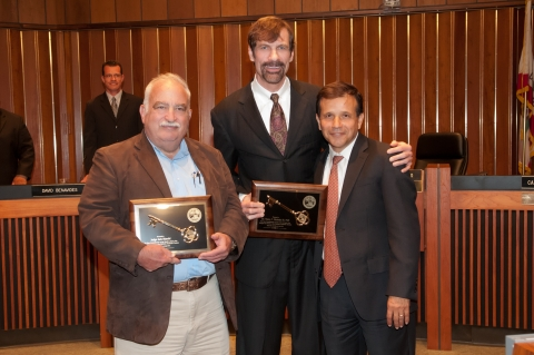 """KEYS TO THE CITY"" OF SANTA ANA AWARDS CEREMONY   On July 2, City of Santa Ana Mayor Miguel A. Pulido presented Nicholas Academic Centers (NAC) Co-Founders Jack K. Mandel and Dr. Henry T. Nicholas, III, PH.D., with Keys to the City of Santa Ana. Mayor Miguel Pulido recognized Dr. Nicholas and Judge Mandel for their outstanding contributions to the community. The recent ceremony marks the first time in ten years that the city has given the award."