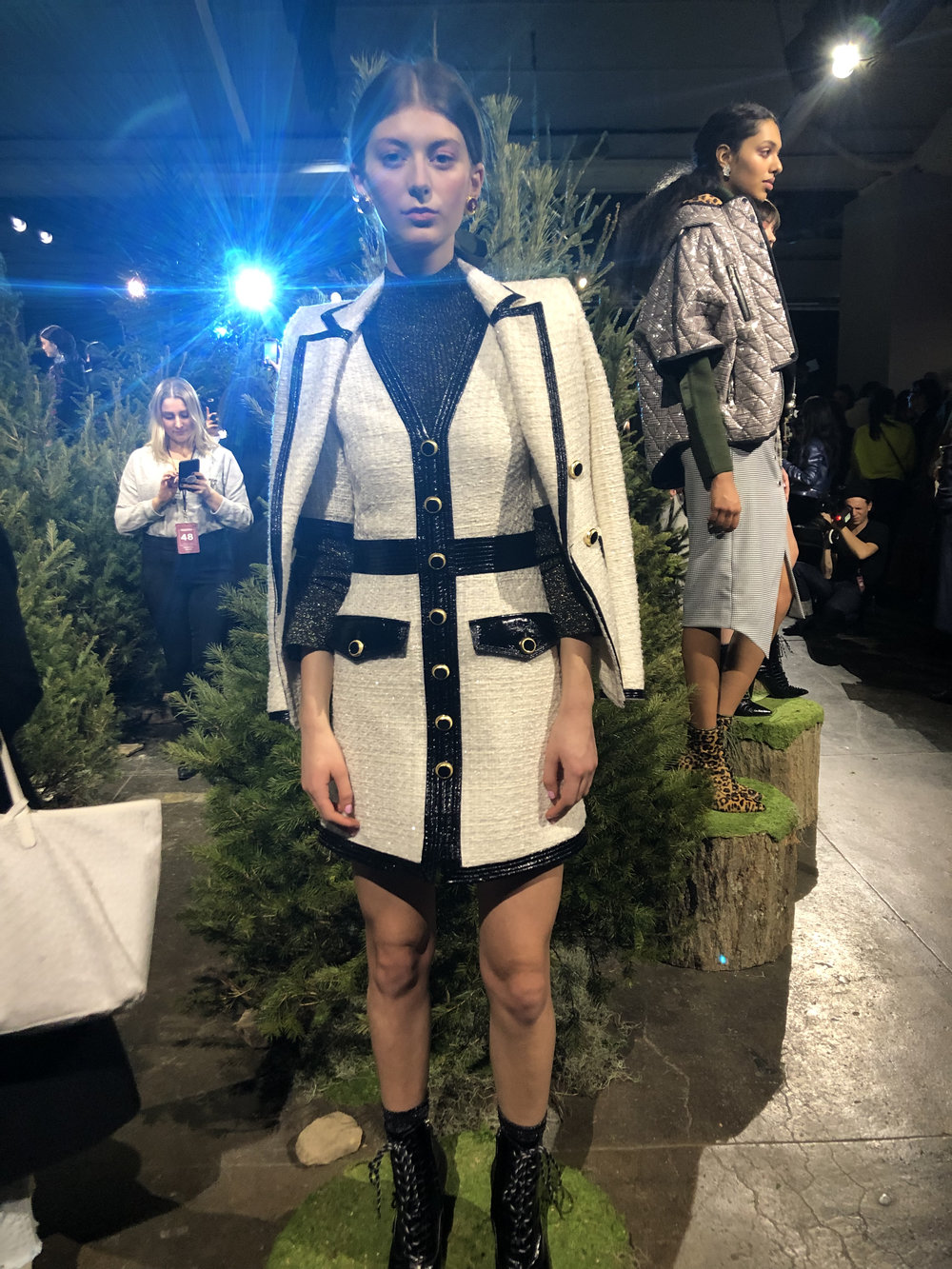 Model is wearing: Black LILA Turtleneck, Ivory SIMONA Dress, Ivory VERONA Jacket, Black PAULA Boots