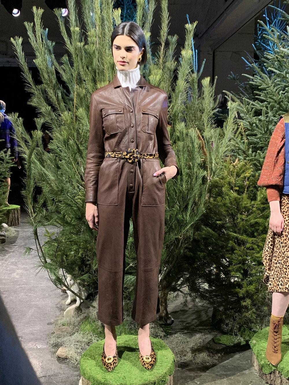 Model is wearing: Off-White NELLIE Turtleneck, Brown ARTEMIS Jumpsuit, Leopard ELSY Belt, Leopard TARTAN Mules