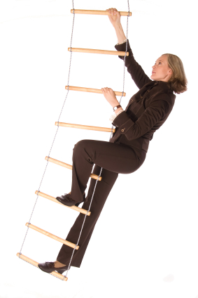 Bussinesswoman climbering  the ladder of success