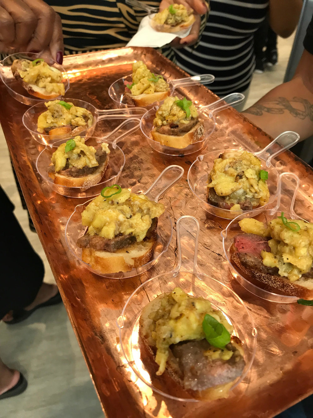 Celebrity Chef J. Jackson's passed hours d' oeuvres were EVERYTHING! Pictured: Mini steak and eggs on  brioche toast