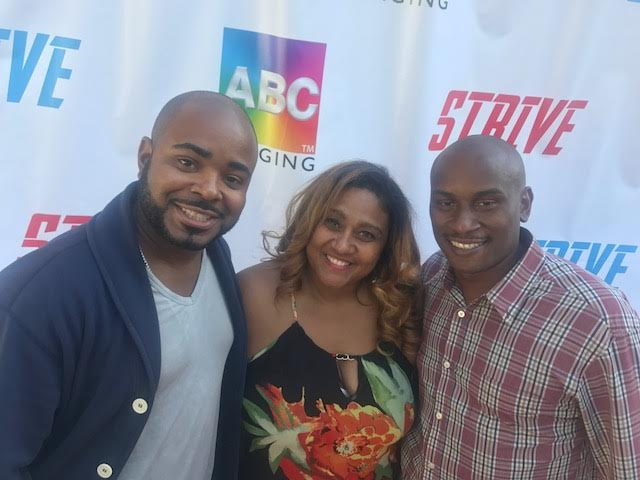 Rhett Butler with Yolanda and Taurus Nelson of STRIVE and Nelson Manor Vacation Rentals