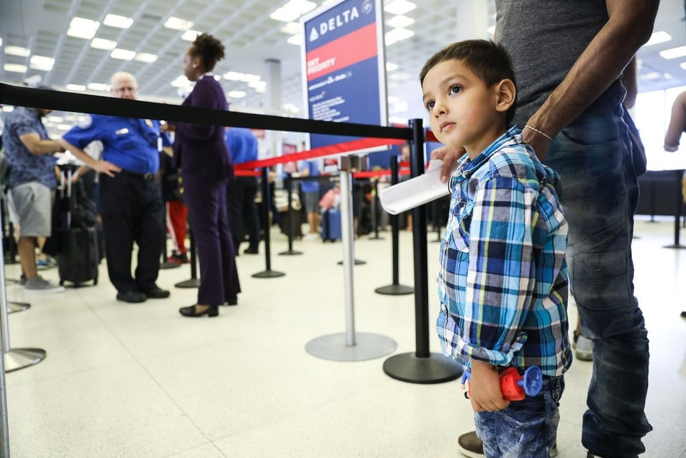 Denis Rivas, 25, and his son, Joshua Rivas Chirino, 4, were reunited last week and then flew to North Carolina to join family there. Marian Carrasquero | The New York Times