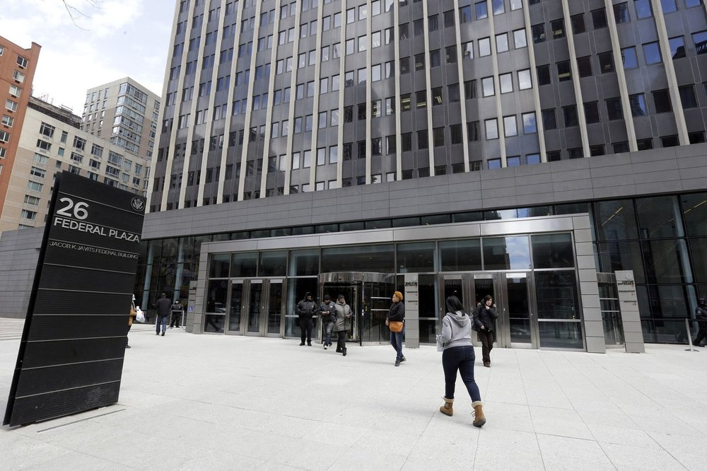 People enter the Jacob K. Javits Federal at 26 Federal Plaza, where New York's immigration court is inside, Wednesday, March 18, 2015. (Mary Altaffer / AP)