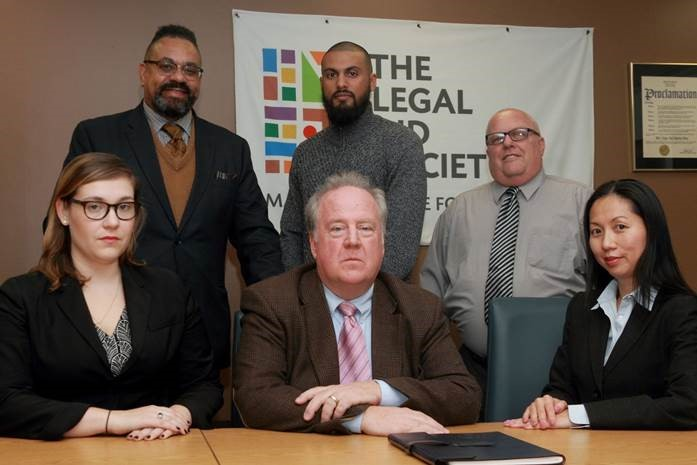 Front from left: Attorneys Julia Burke, Bob Moeller and Jenny Cheung; Back from left: Tim Rountree, Savendra Somdat and David Fritz. This is the legal team that represents Chanel Lewis, charged with the murder of Karina Vetrano. They're pictured in Queens Wednesday afternoon.