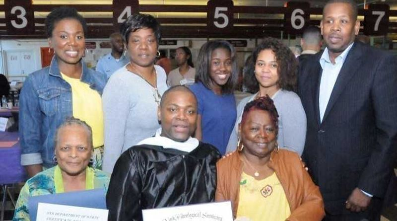 George Hill (in graduation gown, center), has been incarcerated 27 years for shooting a cop in 1991.