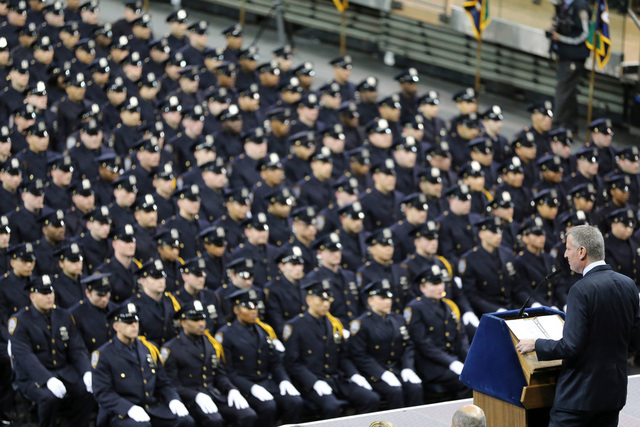 Mayor Bill de Blasio speaking at the NYPD's graduation ceremony at Madison Square Garden (Mary Altaffer/AP/Shutterstock)