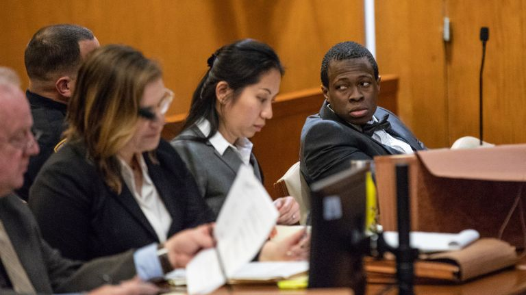 Chanel Lewis, right, sits with his defense team during his retrial Monday for allegedly killing Howard Beach jogger Karina Vetrano. Photo Credit: Pool/ULI SEIT