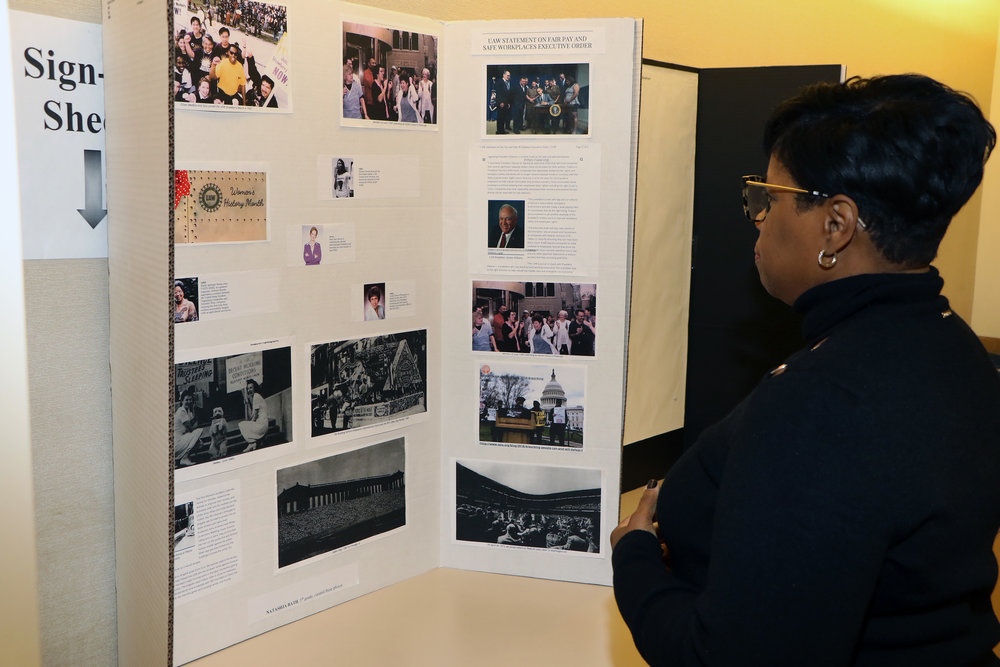 Dawne Mitchell, Attorney-in-Charge of JRP, looks over poster board depicting the amazing history of women in the labor movement.