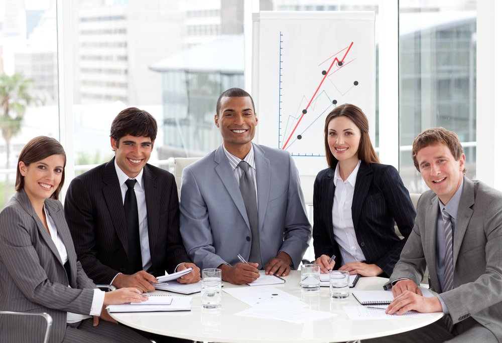 Diverse group of business people in front of a graph