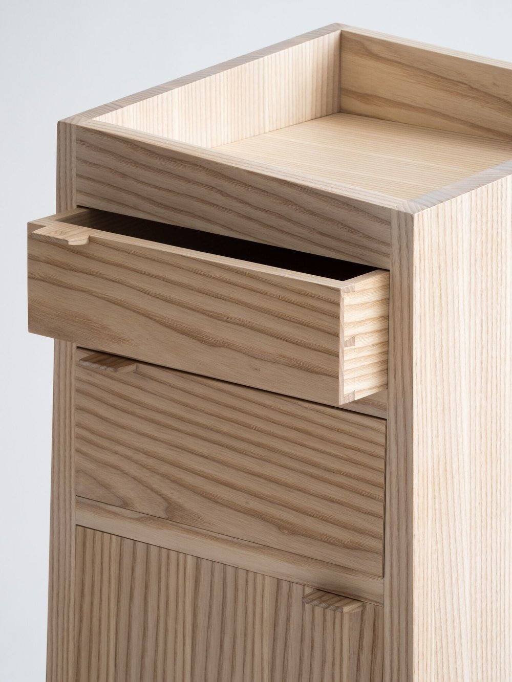 Dovetail drawers. White-washed ash. - Each drawer and door has a custom made pull tab with a subtle imprint for your thumb.This piece is also available in walnut, cherry, white oak and maple.For a quote please contact me.