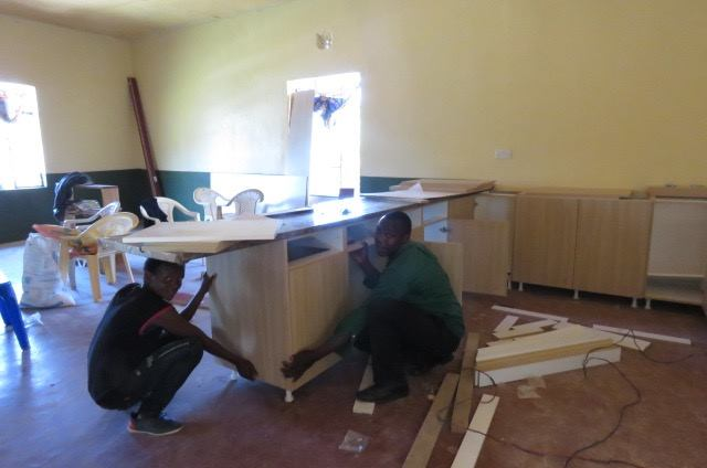 Silas and Fred installing the kitchen.