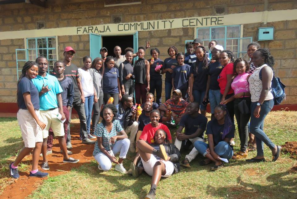 Studenst from Chuka University posing for a group photo outside the centre.
