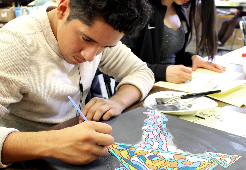 """JM senior Axel Vera works on his piece for """"The World Around You: A Celebration of Art"""" during Rahma Mateen-Mason's Honors Art VI class."""