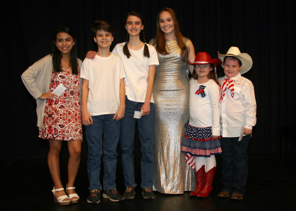 Winners of Sing and Play '19 were, from left, Jennifer Trejo Benitez of Jordan-Matthews High School, Buck and Maggie Thornton of Chatham Middle School, emcee Sydney Suits, and Jillian and Jack Dixon of Silk Hope School. (Photo by Chip Pate)