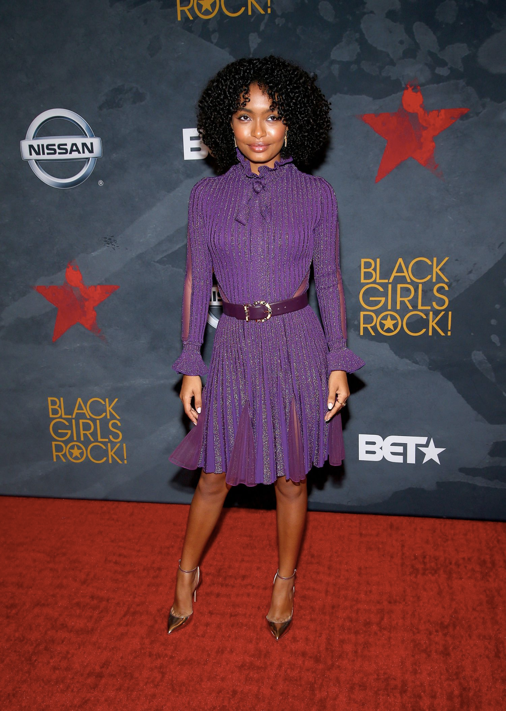 (via: BET.com)    Blackish star Yara Shahidi stunned in this purple bell sleeved garment.