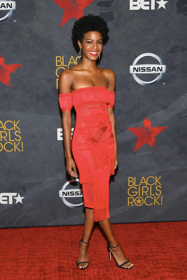 (via: Essence)    Ebonee Davis looking vibrant in this red ,off the shoulder and frilled dress