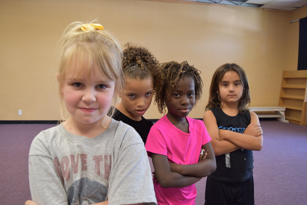 A sampling of the expressive faces of our youngest students.
