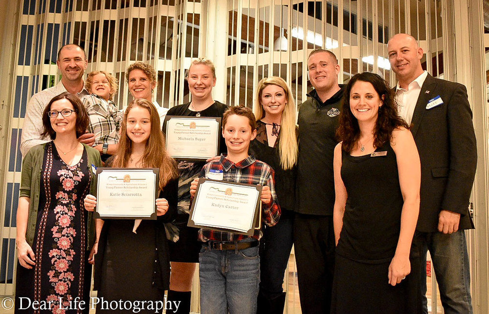 Scholarship Sponsors - Pictured with the 2017 Young Farmer Scholarship winners are Alex and Alisha Rodenko (back left) of Emerald Installations and Scott and Jessica Sergeant of the 19th Hole Bar and Grill (back middle).  Also pictured are Farm Funk Founders Amy Musselwhite, Jess Sappington, and Matt Musselwhite.