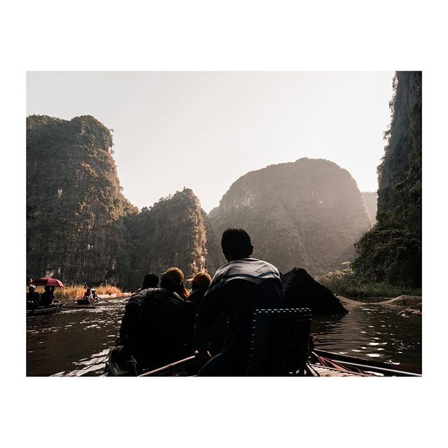 Rowing along the river in Tam Coc, Vietnam
