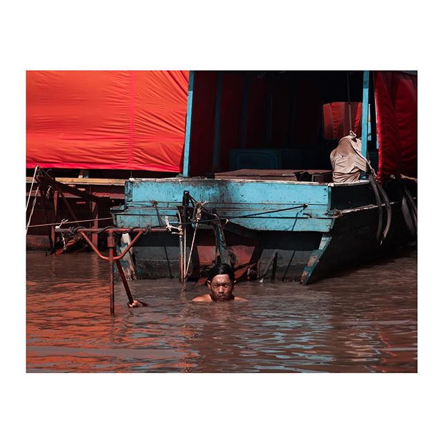 Morning dip in Tonlé Sap Lake, Cambodia