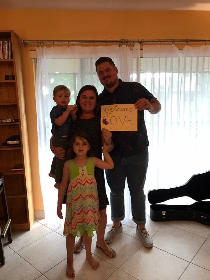 Pastor Jorge and his family posing with our first sign as they welcomed people for their first church service in their home in 2017.