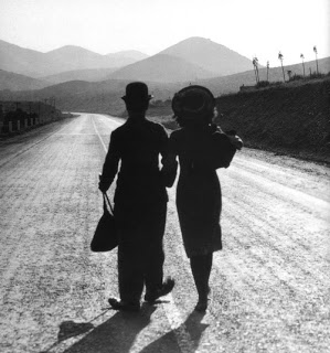- Paulette Goddard and Chaplin strolling a film set, Paulette was Charlie's third wife.