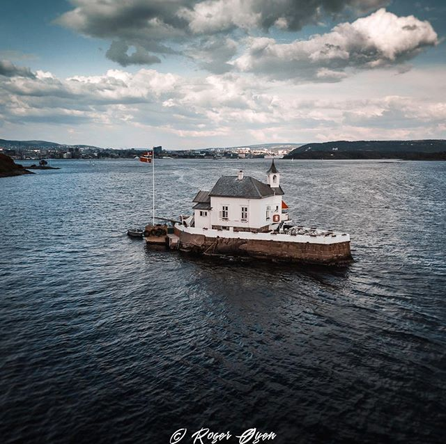 """In his blue gardens men and girls came and went like moths among the whisperings and the champagne and the stars..."" #quotes #rogeroyen # ocean #dji #djimavicair #drone #oslo #norway #blue #tourism #beautiful #chapel #bay #water #landscape #sky #vivid #follow #peaceful #nature #photography #picoftheday #photooftheday #aqua #sea #coast #summer #flag"