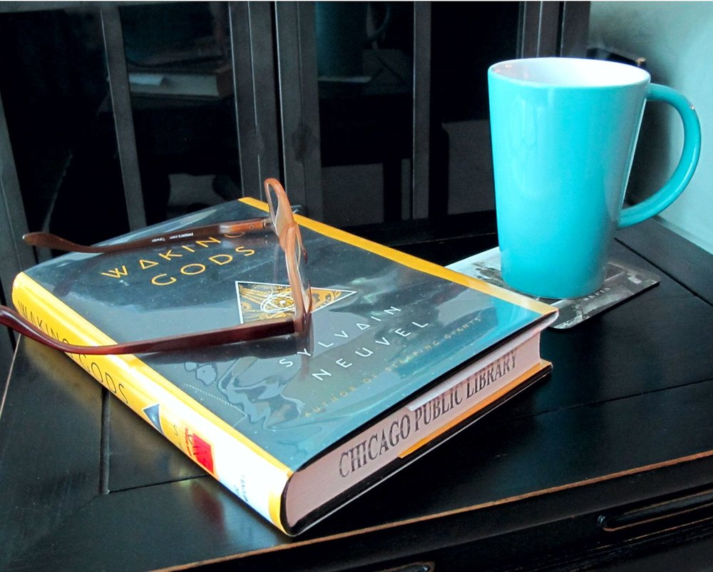 NEVER UNDERESTIMATE THE POWER OF A CUP OF TEA & A GOOD BOOK