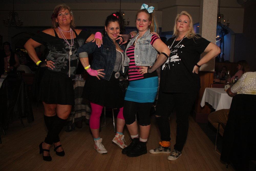 Lisa S., Lisa B., Theresa & Tina rocking '80s garb - Photo by Elissa Den Hoed. Courtesy SnapdKW