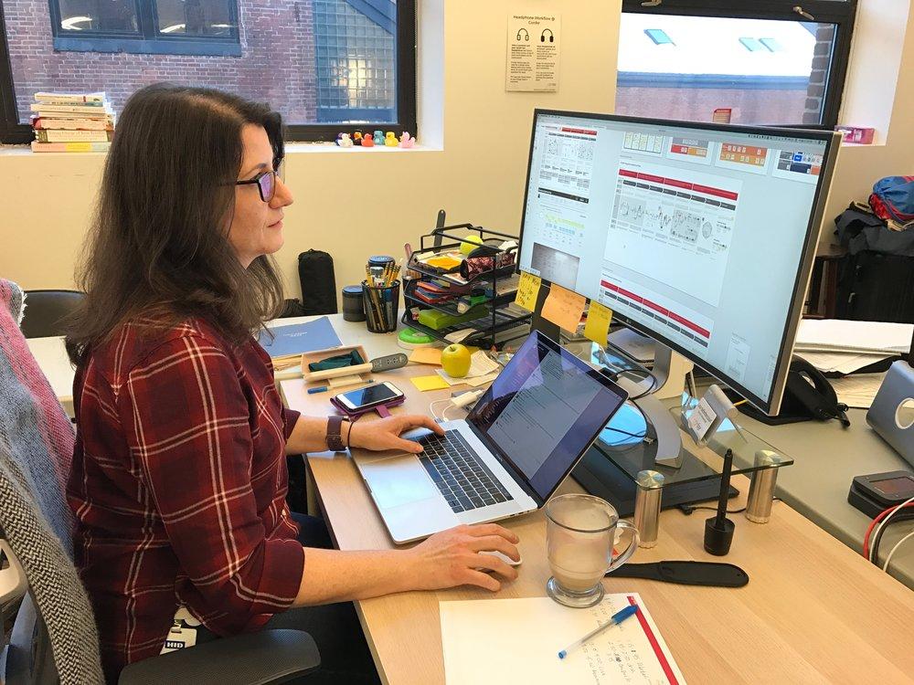 Lisa at her workstation at Confer Health.